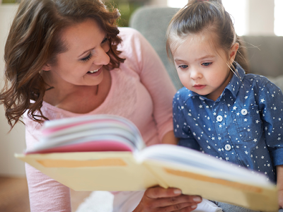 child_reading_to_mother