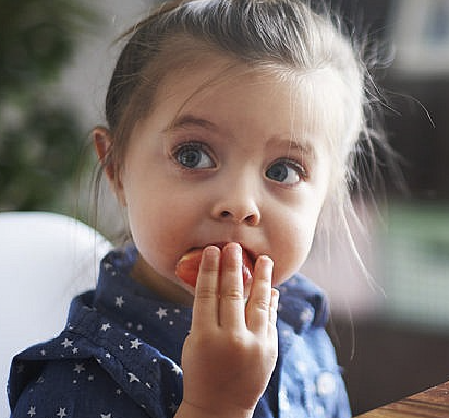 Child eating nutritious meal